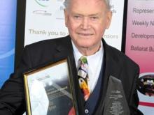 Bill with his awards